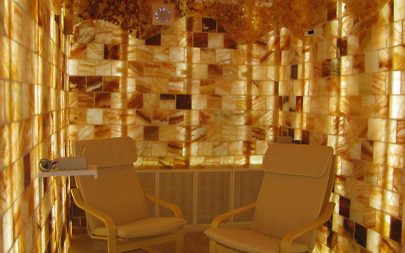 A small salt room with backlighted Himalayan salt bricks by Halomed